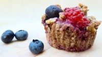 Image shows a flaxseed muffin with raspberries, blueberries, and walnuts, as described in this recipe on CALMERme.com
