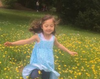 Sunshine image of girl running through the flowers, linking to Vitamin D production from the sun, from CALMERme.com