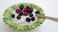 The image shows a dish of homemade organic dairy-free cashew yogurt, as described in this recipe on CALMERme.com