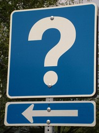 Image of a question mark and direction arrow to illustrate the need to ask yourself the questions outlined in this article on CALMERme.com before deciding whether a clinical trial is appropriate for you.