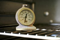 Image of an old-fashioned oven thermometer showing a low temperature reading, depicting the notion that food temperature can make a difference when dealing with nausea, as described in this article on CALMERme.com