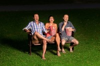 Image of three people watching an outdoor movie and laughing - benefits on immune system CALMERme.com